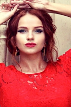 Ukrainian girl Lyubov,25 years old with grey eyes and red hair.