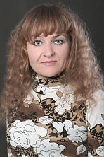 Ukrainian girl Oksana,41 years old with grey eyes and blonde hair.