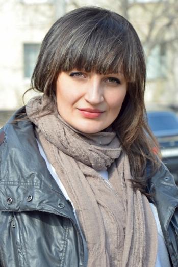 Ukrainian girl Anna ,26 years old with grey eyes and dark brown hair.