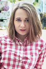 Ukrainian girl Anastasia,23 years old with grey eyes and light brown hair.