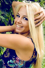 Ukrainian girl Elina,26 years old with green eyes and blonde hair.