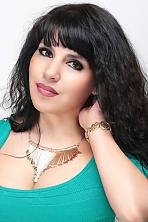 Ukrainian girl Alfiya,44 years old with brown eyes and black hair.