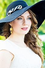 Ukrainian girl Olga,24 years old with green eyes and light brown hair.