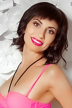 Ukrainian girl Natali,33 years old with green eyes and black hair.