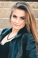 Ukrainian girl Anna,20 years old with green eyes and dark brown hair.