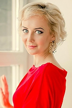 Russian girl Elena,40 years old with blue eyes and blonde hair.