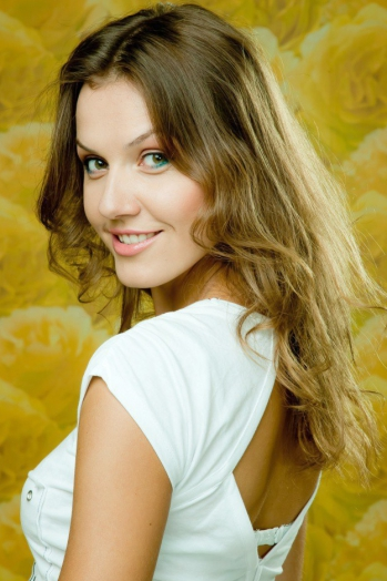 Ukrainian girl Christina,33 years old with green eyes and light brown hair.