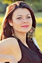 Ukrainian girl Tatyana,26 years old with green eyes and dark brown hair.