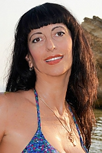 Ukrainian girl Anna,52 years old with brown eyes and black hair.