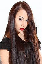 Ukrainian girl Tanya,30 years old with brown eyes and dark brown hair.