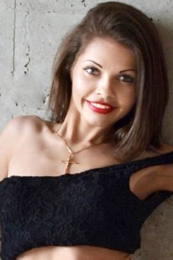 Ukrainian girl Alesia,26 years old with green eyes and dark brown hair.