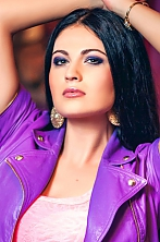 Ukrainian girl Victoria,37 years old with grey eyes and black hair.