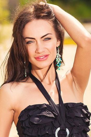 Ukrainian girl Ella,34 years old with grey eyes and black hair.