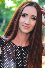 Ukrainian girl Tatyana,32 years old with brown eyes and dark brown hair.