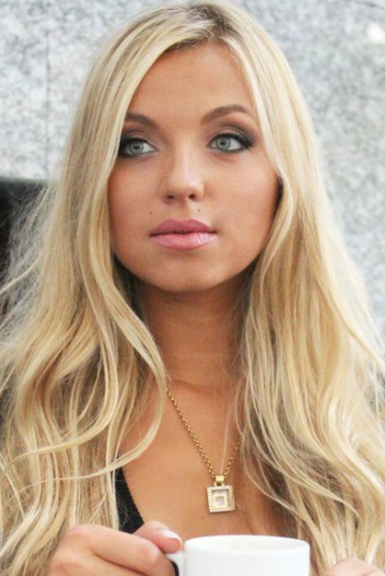 Ukrainian girl Lina,24 years old with grey eyes and blonde hair.
