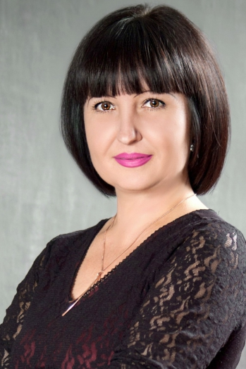 Ukrainian girl Nelya,44 years old with brown eyes and black hair.