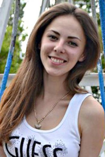 Ukrainian girl Nataliya,22 years old with grey eyes and dark brown hair.
