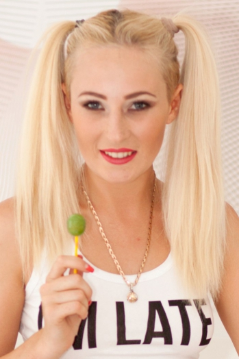 Ukrainian girl Inna,27 years old with blue eyes and blonde hair.