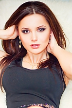 Ukrainian girl Lilia,28 years old with brown eyes and dark brown hair.