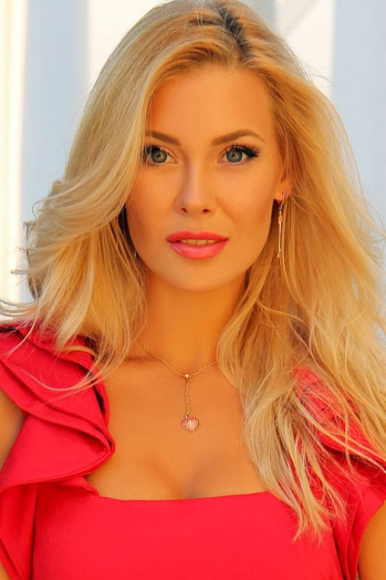 Ukrainian girl Olga,30 years old with blue eyes and blonde hair.