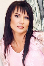 Ukrainian girl Marina,45 years old with grey eyes and black hair.