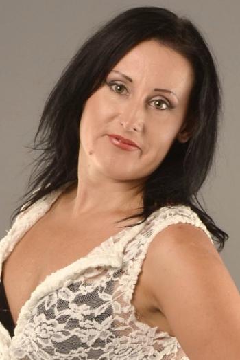 Ukrainian girl Svetlana,33 years old with grey eyes and black hair.
