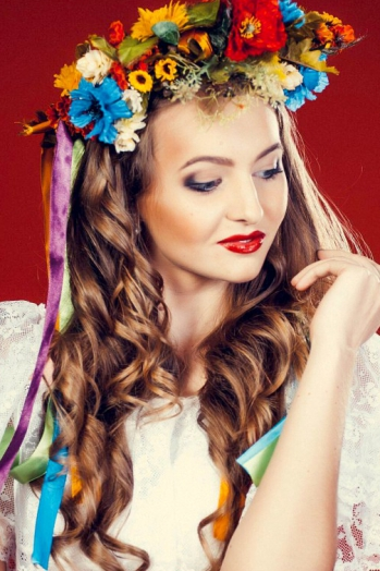 Ukrainian girl Anna,20 years old with blue eyes and blonde hair.