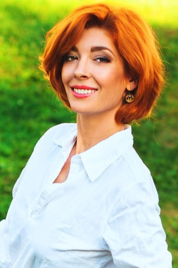 Ukrainian girl Julia,29 years old with brown eyes and red hair.