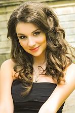 Ukrainian girl Irina,20 years old with brown eyes and dark brown hair.