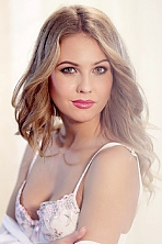Ukrainian girl Oksana,24 years old with green eyes and light brown hair.