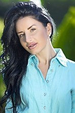 Ukrainian girl Dina,31 years old with brown eyes and black hair.