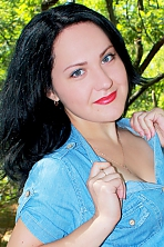 Ukrainian girl Irina,22 years old with blue eyes and black hair.
