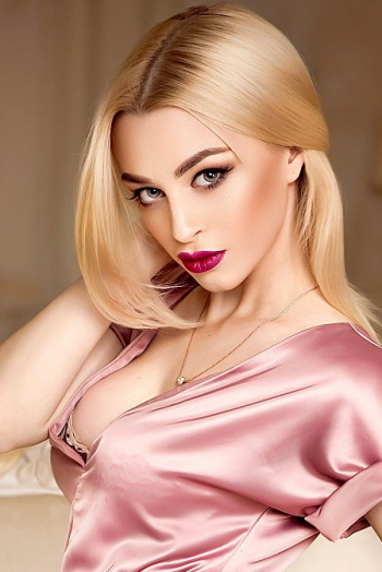 Ukrainian girl Viktoria,22 years old with green eyes and light brown hair.