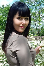 Ukrainian girl Elena,35 years old with green eyes and dark brown hair.