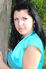 Ukrainian girl Anna,22 years old with grey eyes and black hair.