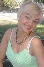 Ukrainian girl Galina,41 years old with hazel eyes and blonde hair.