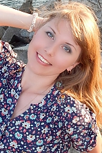 Ukrainian girl Oksana,35 years old with blue eyes and blonde hair.
