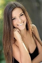 Ukrainian girl Ksenia,24 years old with blue eyes and dark brown hair.
