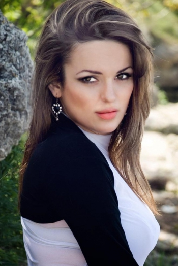 Ukrainian girl Lilia,35 years old with green eyes and dark brown hair.
