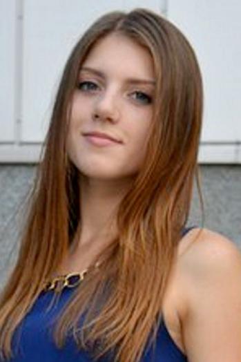 Ukrainian girl Olga,19 years old with blue eyes and dark brown hair.