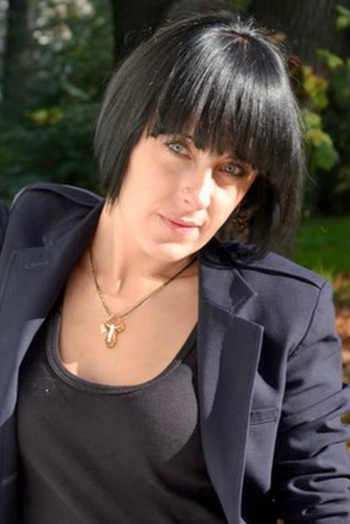 Ukrainian girl Olga,33 years old with green eyes and black hair.
