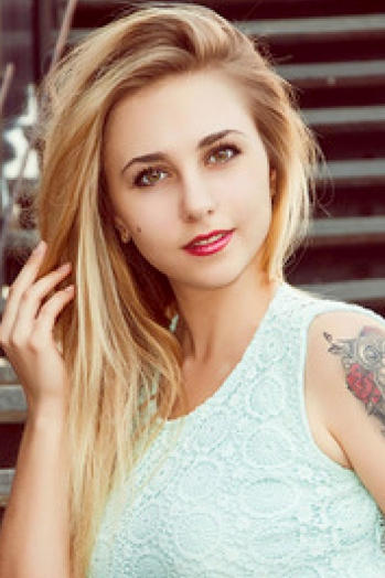 Ukrainian girl Tatyana,21 years old with blue eyes and blonde hair.