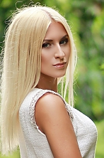 Ukrainian girl Julia,25 years old with blue eyes and blonde hair.