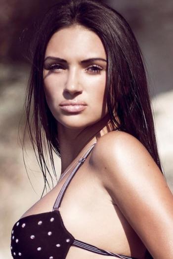 Ukrainian girl Ekaterina,26 years old with hazel eyes and dark brown hair.