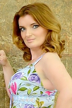 Ukrainian girl Galina,38 years old with blue eyes and red hair.