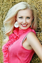 Ukrainian girl Oksana,30 years old with grey eyes and blonde hair.