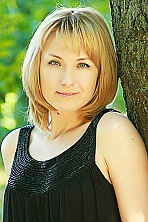 Ukrainian girl Yana,37 years old with blue eyes and blonde hair.
