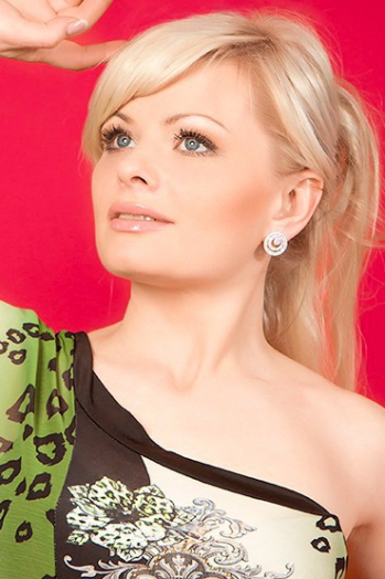 Ukrainian girl Irina,38 years old with blue eyes and blonde hair.