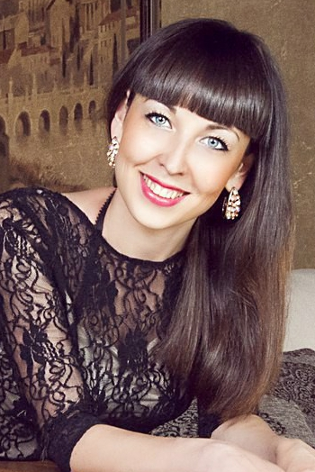 Ukrainian girl Anna,23 years old with blue eyes and dark brown hair.