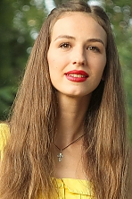 Ukrainian girl Anastasia,25 years old with brown eyes and light brown hair.